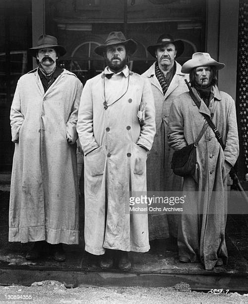 Cliff Robertson Luke Askew RG Armstrong and Wayne Sutherlin arrive at a mid west town in a scene from the film 'The Great Northfield Minnesota Raid'...