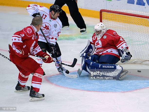 Cliff Ronning of Canada Viacheslav Fetisov and Maxim Mikhailovsky of the USSR during the friendly match between Canada Team and USSR Team during the...