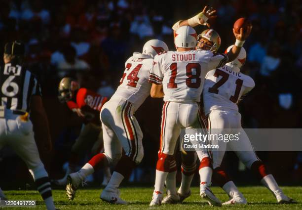 Cliff Stoudt of the St Lous Cardinals attempts a pass during an NFL game against the San Francisco 49ers played on November 9 1986 at Candlestick...