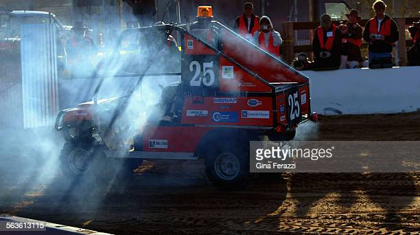 Cliff the autonomous vehicle by Virgina Tech smokes as its brake line burns near the start while participating in the DARPA Grand Challenge in...