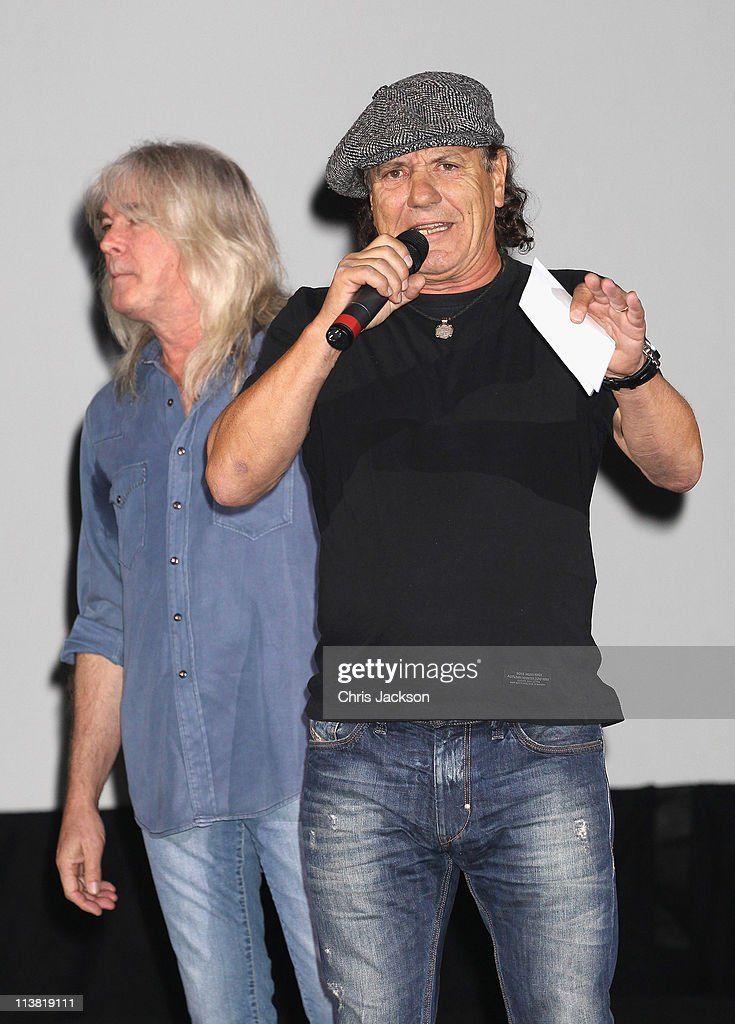Cliff Williams (L) and Brian Johnson of AC/DC on stage at HMV Hammersmith for the World Premiere of 'AC/DC Live at River Plate' Presented by DeLeón Tequila on May 6, 2011 in London, England.