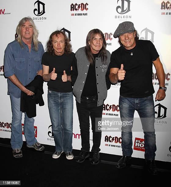 Cliff Williams Angus Young Malcolm Young and Brian Johnson of AC/DC arrive at HMV Hammersmith for the World Premiere of 'AC/DC Live at River Plate'...
