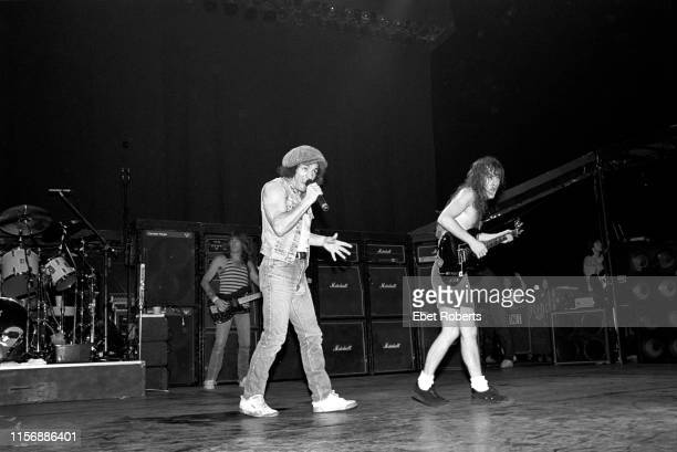 Cliff Williams , Brian Johnson and Angus Young of AC/DC performing at Nassau Colliseum in Uniondale, New York on November 21, 1985.