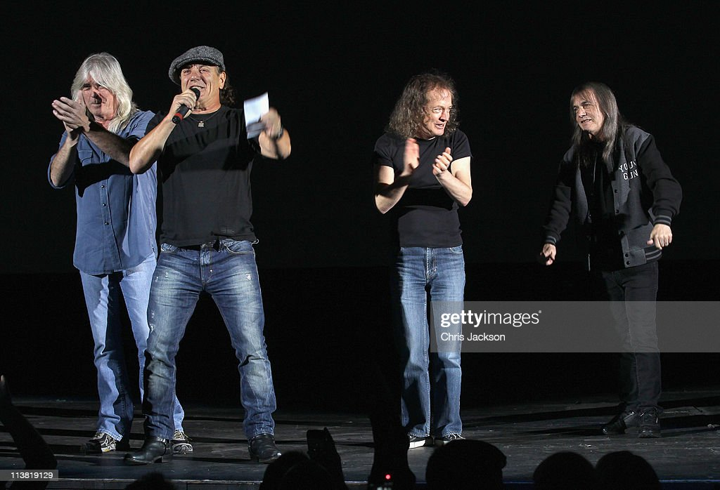 Cliff Williams, Brian Johnson, Angus Young and Malcolm Young of AC/DC are on stage at HMV Hammersmith for the World Premiere of 'AC/DC Live at River Plate' Presented by DeLeón Tequila on May 6, 2011 in London, England.
