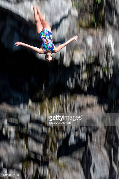 A cliffdiver jumps from a 15 metre rock during the training session of the Cliff Diving European Championship on July 18 2014 in Ponte Brolla near...