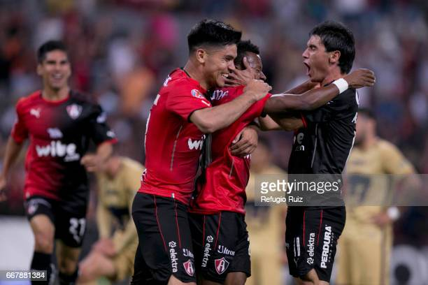 Clifford Aboagye of Atlas celebrates with teammates after scoring the first goal of the game during the 10th round match between Atlas and Pumas UNAM...