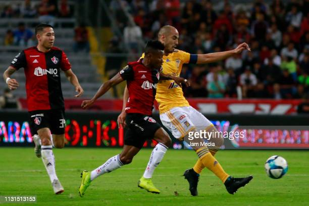 Clifford Aboagye of Atlas fights for the ball with Guido Pizarro of Tigres during the 8th round match between Atlas and Tigres UNAL as part of the...