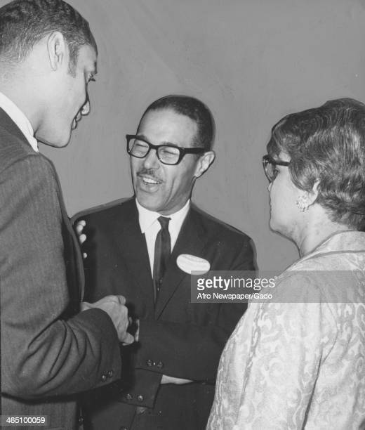 Clifford Alexander of the Equal Opportunities Commission chats with John Murphy III of the Afro American Newspapers December 21 1968