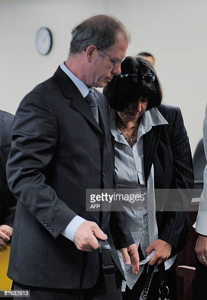 Clifford and Yvonne Entwistle of Great Britian parents of accused murderer Neil Entwistle leave the court room during a break in the trial at the...