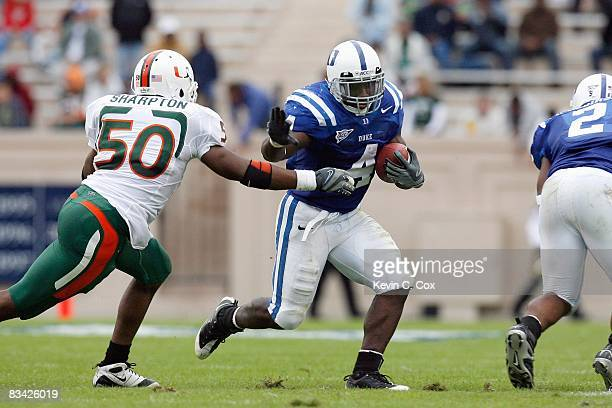 Clifford Harris of the Duke Blue Devils carries the ball against Darryl Sharpton of the Miami Hurricanes at Wallace Wade Stadium on October 18 2008...