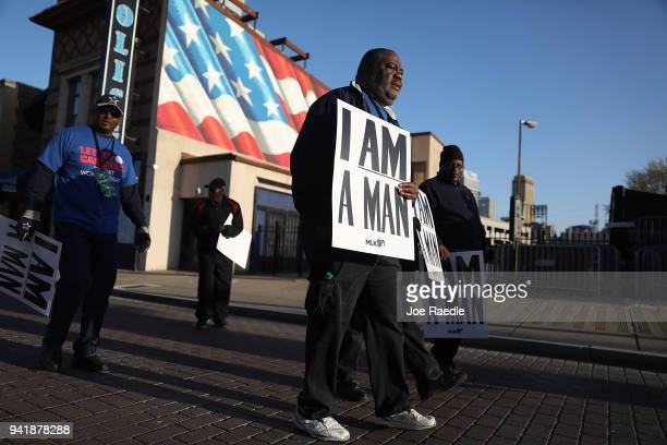 Clifford Jefferson holds 'I Am A Man' signs in reference to the sanitation workers strike in 1968 as he participates in an event to mark the 50th...