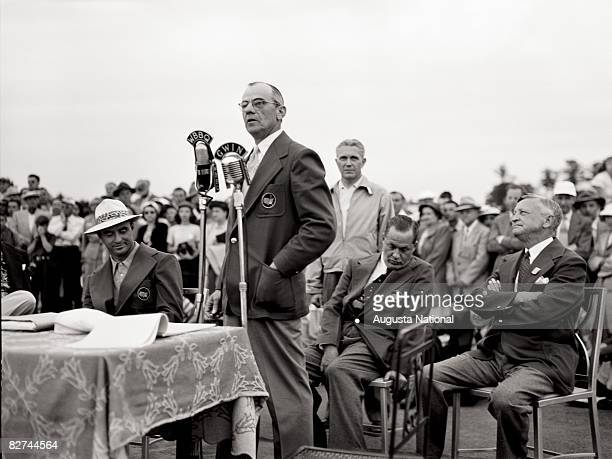 Clifford Roberts talks at the Presentation Ceremony while Sam Snead and Bobby Jones listen during the 1949 Masters Tournament at Augusta National...