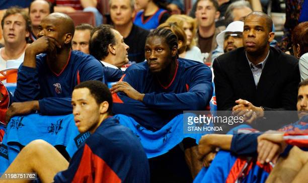 Clifford Robinson Ben Wallace Hubert Davis and Tayshaun Prince on the Detroit Pistons bench look on in the fourth quarter as their team loses to the...