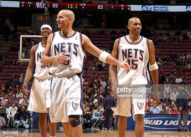 0683a6ff180f Clifford Robinson Jason Kidd and Vince Carter of the New Jersey Nets  celebrate against the Washington