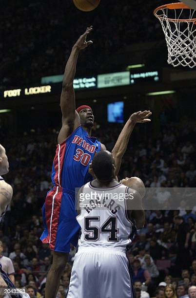Clifford Robinson of the Detroit Pistons shoots a hook shot over Rodney Rogers of the New Jersey Nets in Game Four of the Eastern Conference Finals...