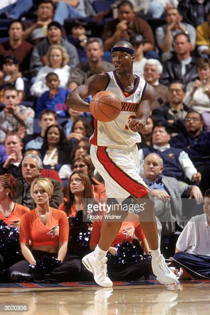 Clifford Robinson of the Golden State Warriors passes the ball against the Seattle Sonics during the game on February 21 2004 at the Arena in Oakland...