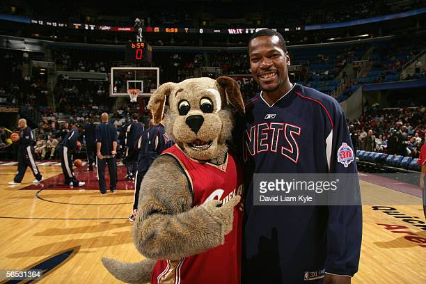 Clifford Robinson of the New Jersey Nets poses for a photo with Moondog, the Cleveland Cavaliers mascot, prior to a game at Quicken Loans Arena on...