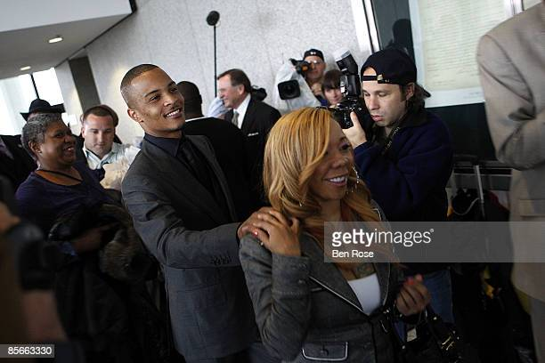 """Clifford """"T.I."""" Harris and fiance Tameka Cottle leave the Richard B. Russell Federal Building and United States Courthouse for on March 27, 2009 in..."""