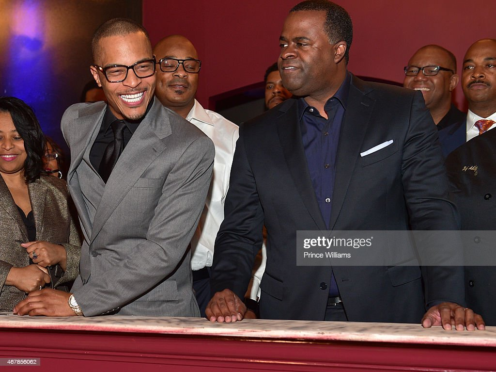 Clifford 'T.I.' Harris and Kasim Reed attend 925 Scales ribbon cutting Ceremony at 925 Scales on March 27, 2015 in Atlanta, Georgia.