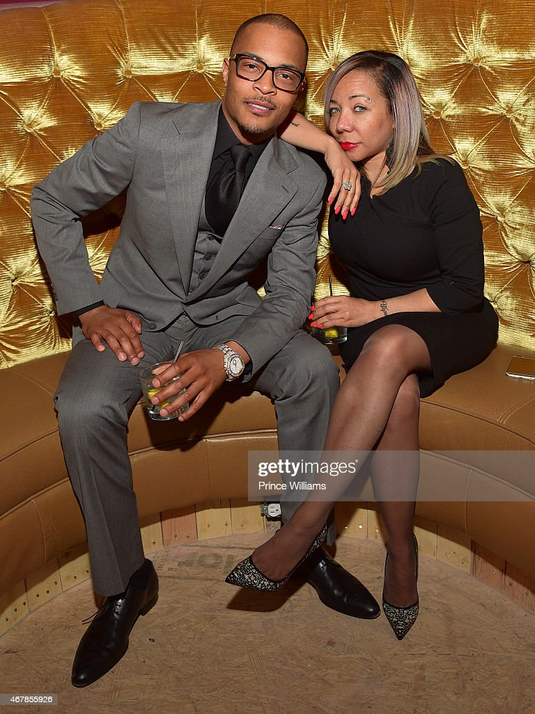 Cliffors 'T.I.' Harris and Tameka 'Tiny' Harris attend 925 Scales Ribbon Cutting Ceremony at 925 Scales on March 27, 2015 in Atlanta, Georgia.
