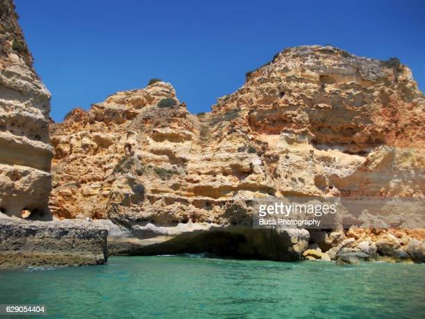 Cliffs and caves on the coastline, near Benagil Beach, near Lagoa in the region of Algarve, the southernmost region of continental Portugal