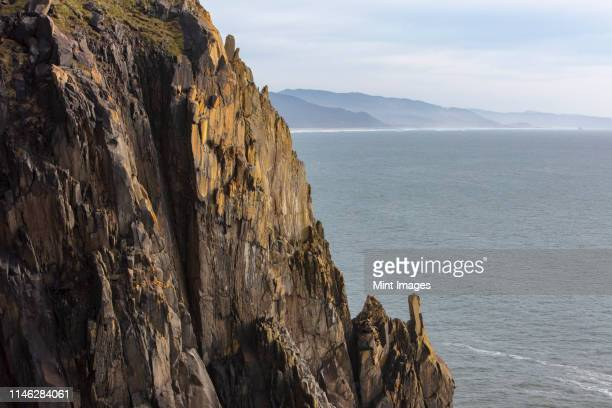 cliffs and coastline on the pacific coast. - steep stock photos and pictures