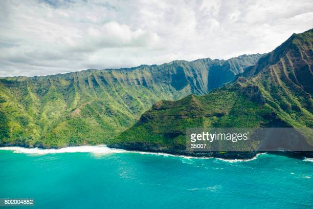 cliffs and green valley kauai, hawaii islands - na pali coast stock photos and pictures