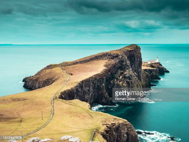 cliffs and neist point lighthouse, scotland. isle of skye in spring. popular place for travel lovers - scottish highlands stock pictures, royalty-free photos & images