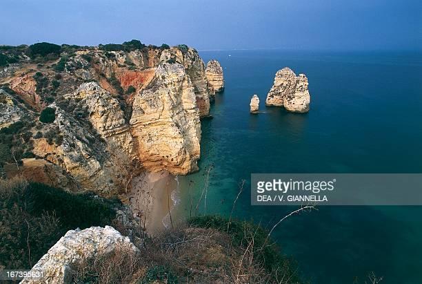 Cliffs and rocks on the coast between the promontory of Ponta da Piedade and Ponta d'Ana Faro district Algarve Portugal