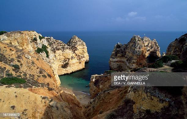 Cliffs and rocks on the coast between the promontory of Ponta da Piedade and Ponta d'Ana Faro district Algarve Portugal