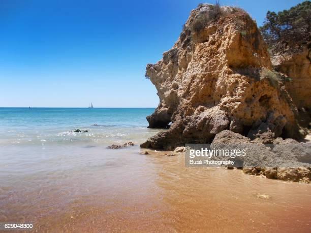 Cliffs and rocks on the coastline, near Albufeira, in the district of Faro, Algarve, Portugal