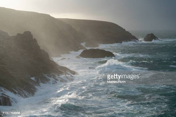 cliffs and storm with huge waves - flowing cape stock pictures, royalty-free photos & images