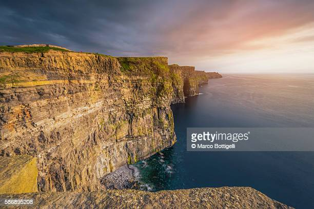 Cliffs of Moher (Aillte an Mhothair), Doolin, County Clare, Munster province, Ireland, Europe. Sunset over the cliffs.