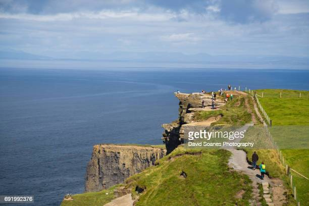 cliffs of moher in county clare, ireland - ジオパーク ストックフォトと画像