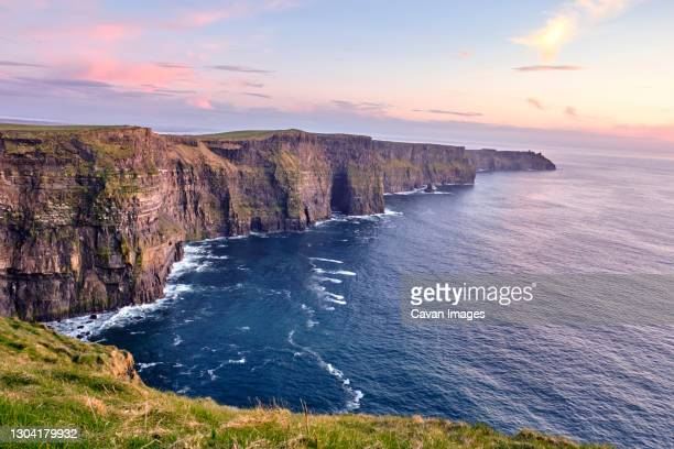 cliffs of moher tourist destination at sunset - 2018 stock pictures, royalty-free photos & images