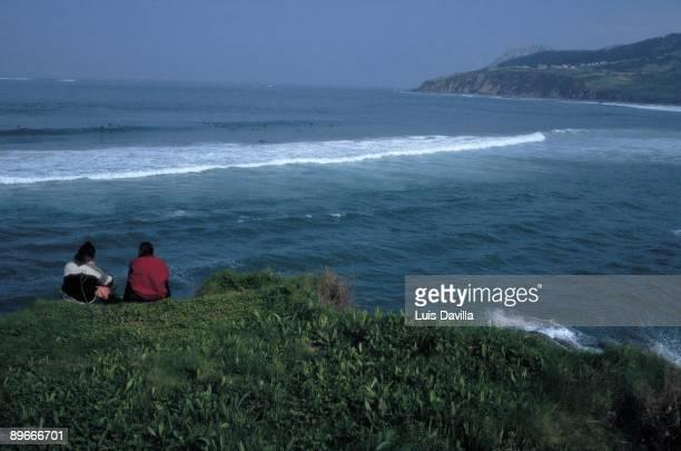 Cliffs of Mundaka Two people observe the sea from the cliffs of the town of Mundaka Biscay province