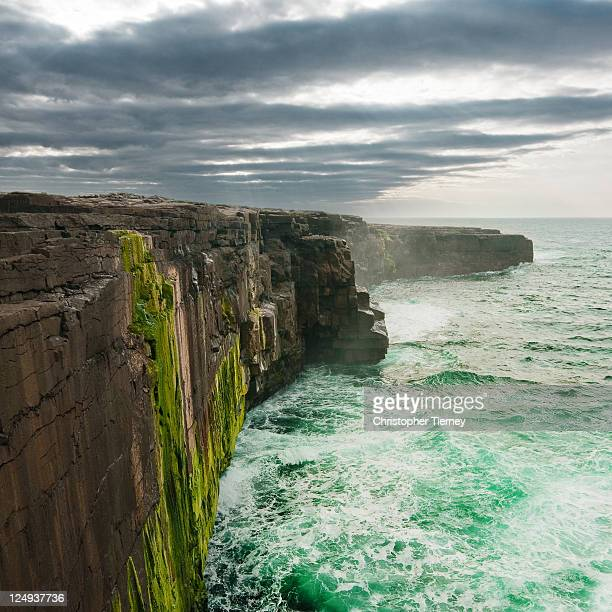 cliffs on  inismeann. - galway stock pictures, royalty-free photos & images