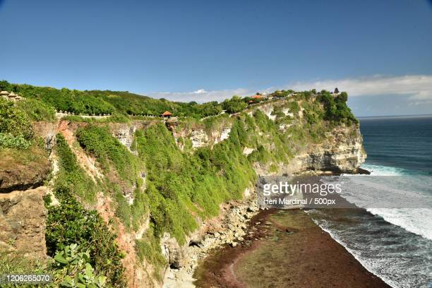 cliffs overlooking blue sea in summer - heri mardinal stock pictures, royalty-free photos & images