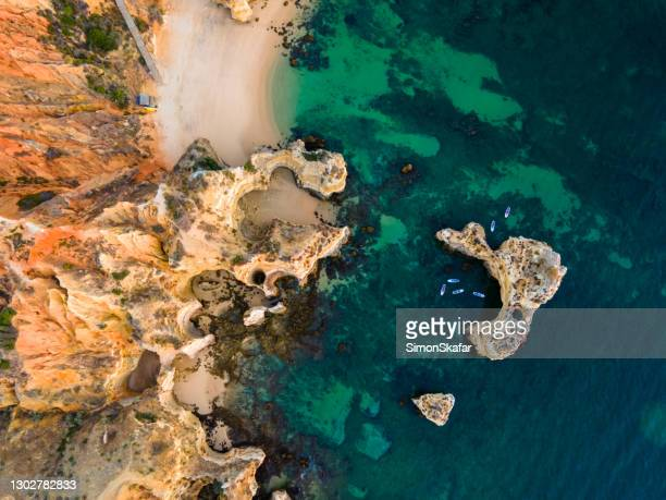 cliffs with rock formations at ponta da piedade - rocky coastline stock pictures, royalty-free photos & images