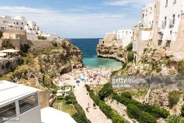clifftop coastal town beach - polignano a mare stock photos and pictures
