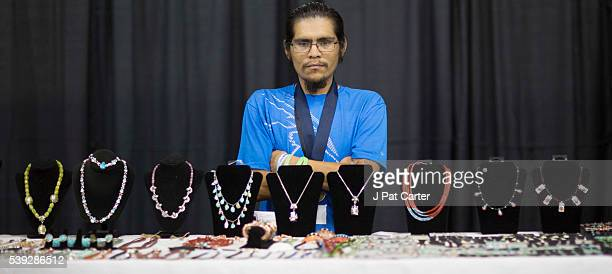 Clifton Aguilar of the Kewa Pueblo in New Mexico displays his hand made jewelry at the Red Earth Native American Festival Friday June 10 2016 in...