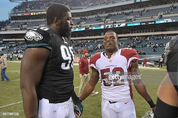 Clifton Geathers of the Philadelphia Eagles and Jasper Brinkley of the Arizona Cardinals talks after the game at Lincoln Financial Field on December...