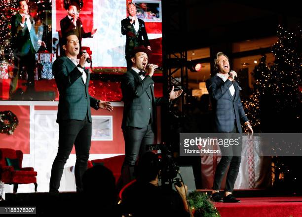 Clifton Murray Victor Micallef and Fraser Walters of The Tenors perform at Christmas at The Grove A Festive Tree Lighting celebration at The Grove on...