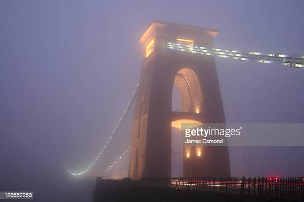 Clifton Suspension Bridge disappearing into the mist in Bristol.