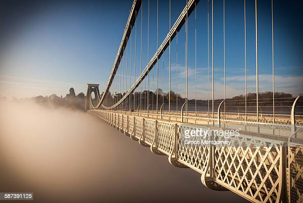 clifton suspension bridge on a misty morning - bristol stock photos and pictures