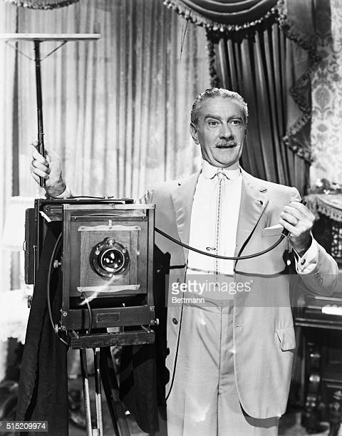 Clifton Webb about to take a picture with old time camera and flash powder Movie still from Sitting Pretty