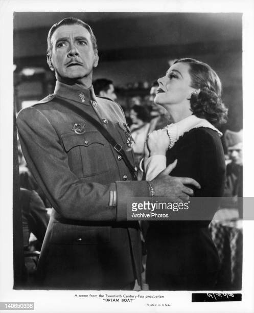 Clifton Webb holding unidentified woman as he looks away in a scene from the film 'Dreamboat' 1952