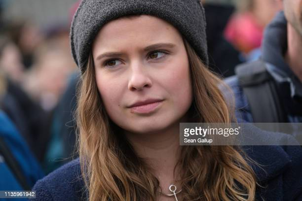 Climate activist Luisa Neubauer attends a FridaysForFuture climate protest march outside the Chancellery on March 15 2019 in Berlin Germany According...
