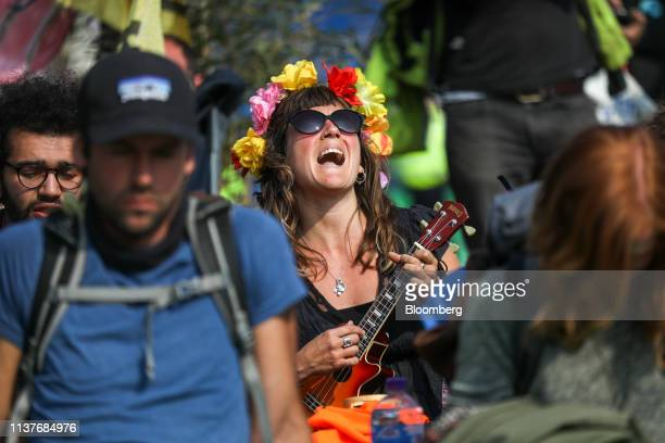 A climate activist plays a ukulele during a protest on Waterloo Bridge in London UK on Wednesday April 17 2019 Activists from the group Extinction...