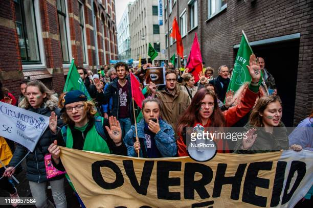 Climate activists are walking to the Tweede Kamer during a demonstration in support of the Urgenda case that took place in front of the Supreme Court...